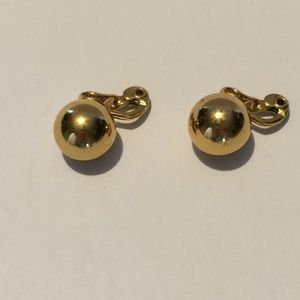 Vintage round gold tone clip on earrings